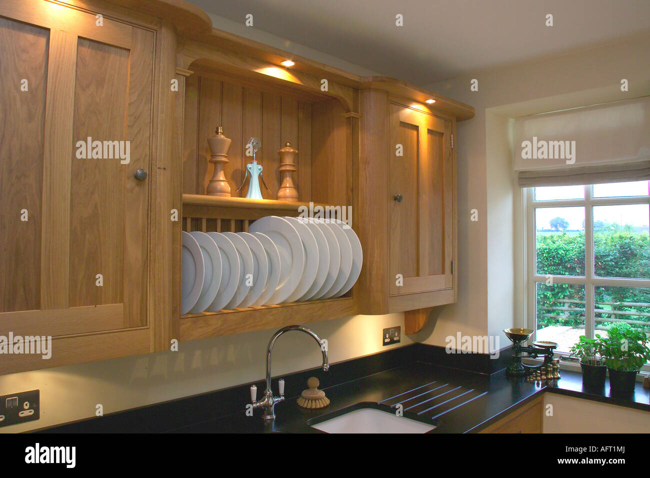 Lighting above plate rack between wooden cupboards in modern kitchen & Lighting above plate rack between wooden cupboards in modern kitchen ...