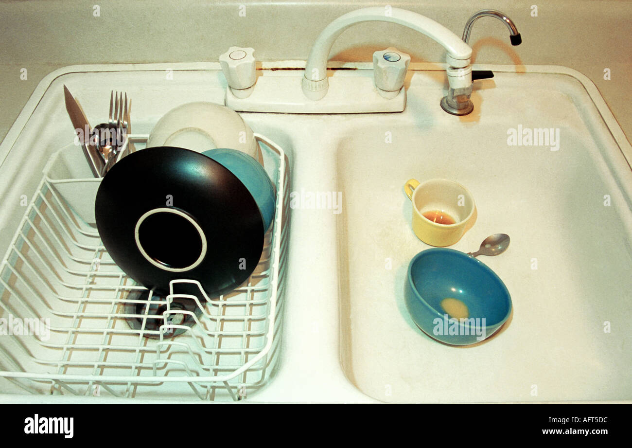 Dirty Dishes in Sink - Stock Image