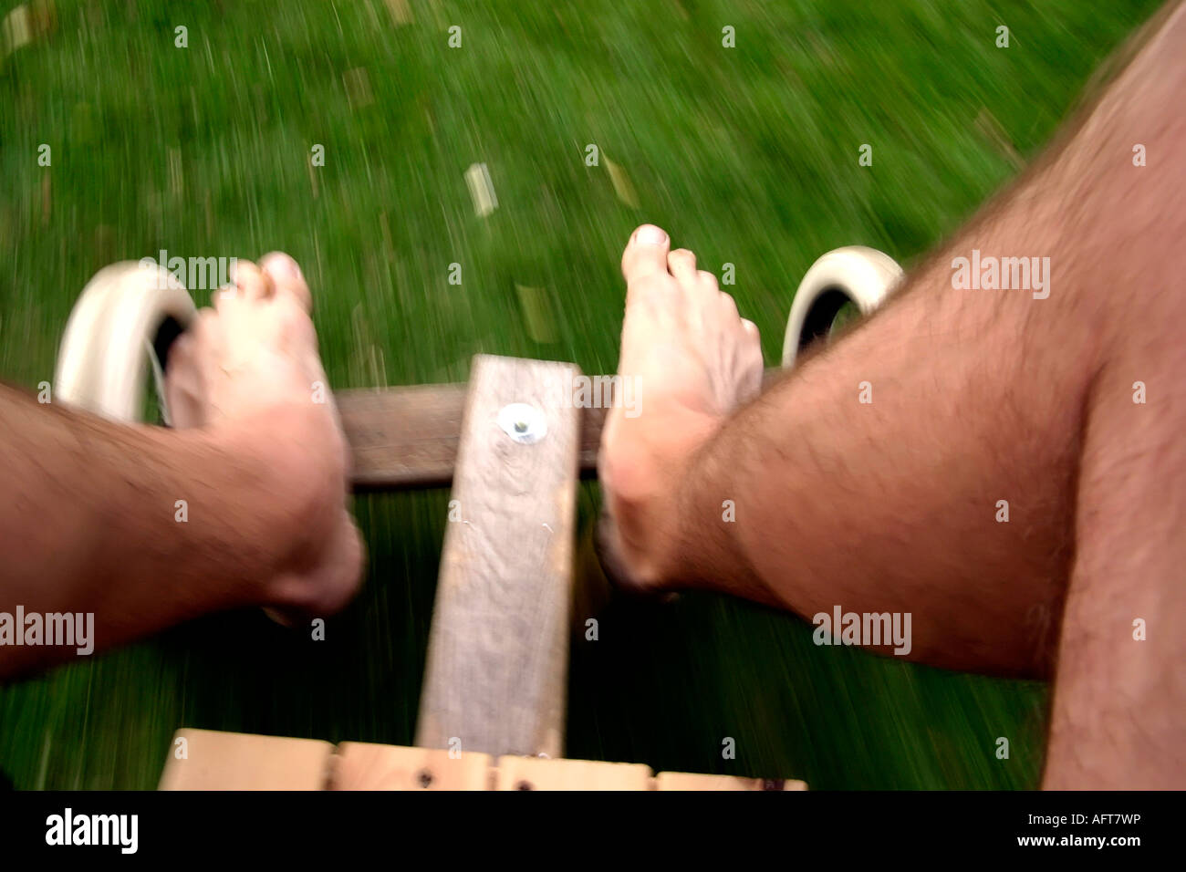 Man S Feet Steering A Home Made Go Kart At Speed Over Grass Stock Photo Alamy