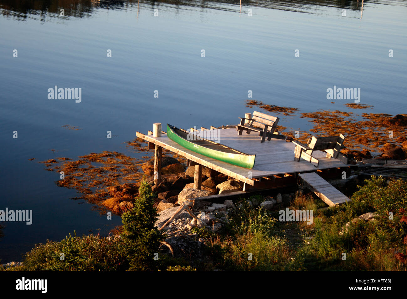 jetty with Old Town canoe at the Atlantic Ocean, Nova Scotia