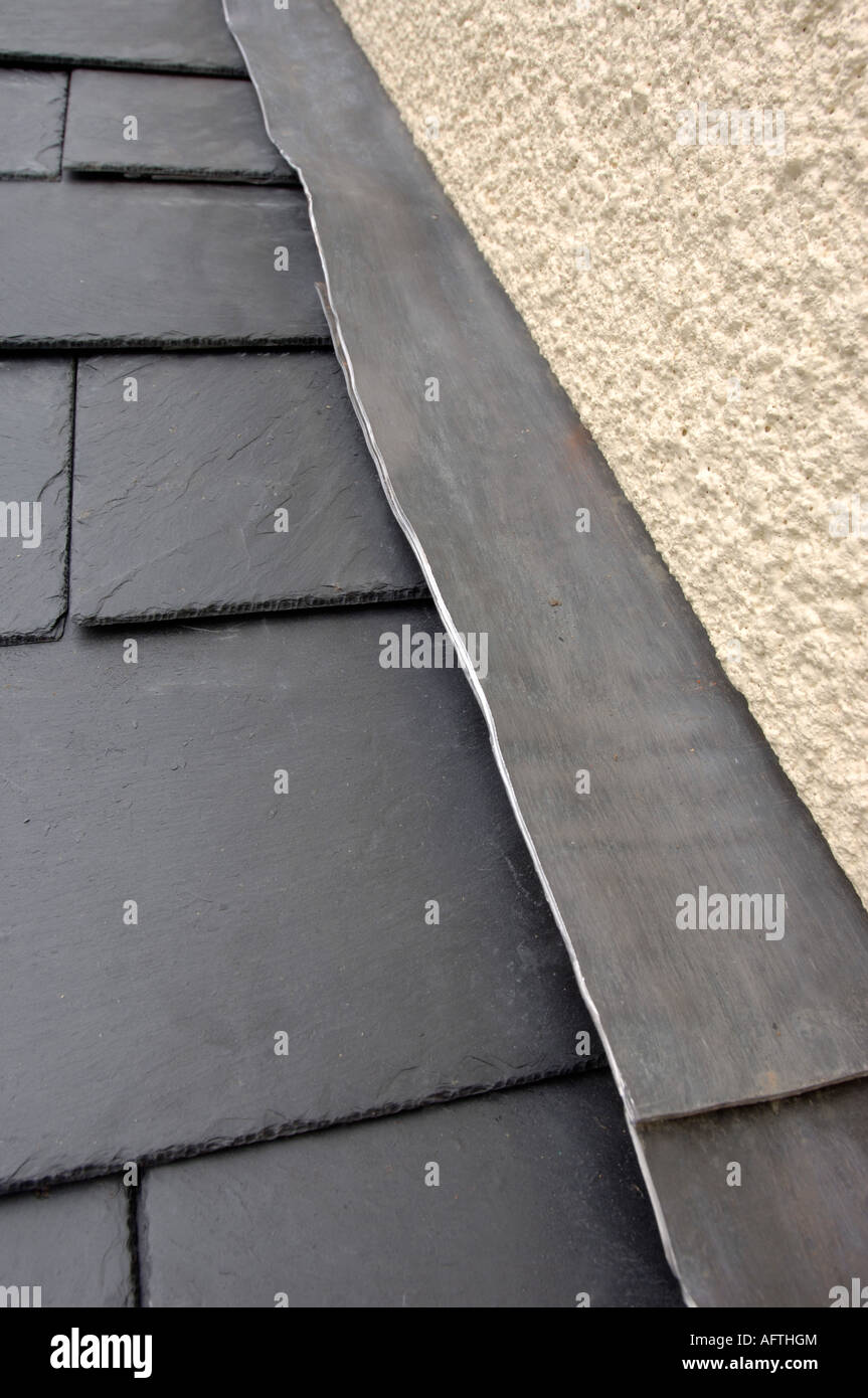 A Slate Roof Joining A Rendered Wall With Lead Flashing