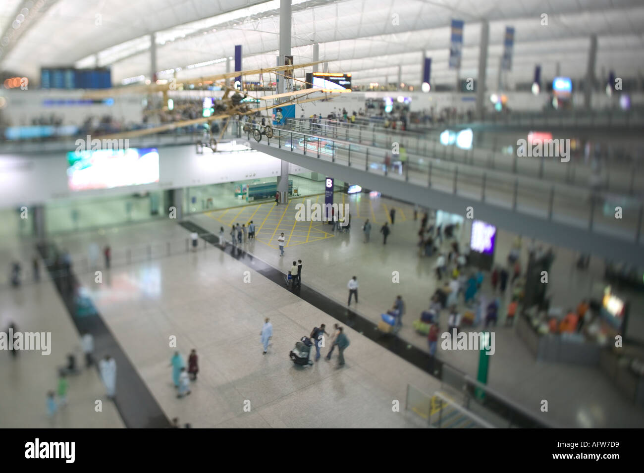 Passengers at the arrivals area of Hong Kongs Chek Lap Kok airport - Stock Image