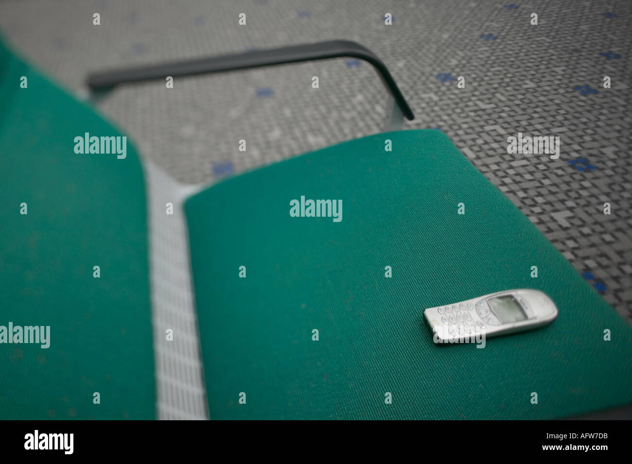 Mobile Phone left on chair at Hong Kongs Chek Lap Kok airport - Stock Image
