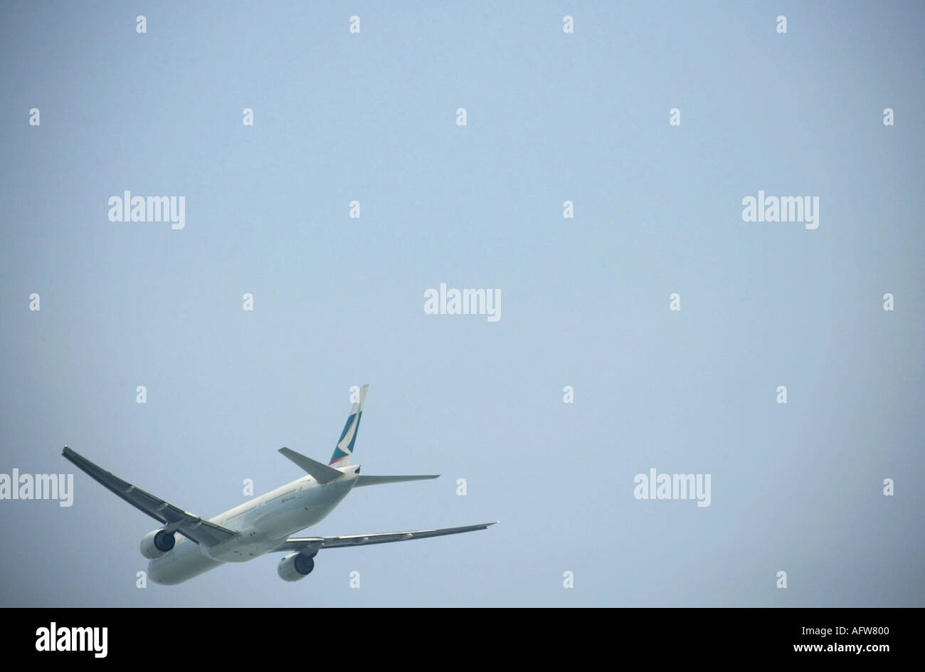 Cathay Pacific after taking of from Hong Kongs Chek Lap Kok airport - Stock Image