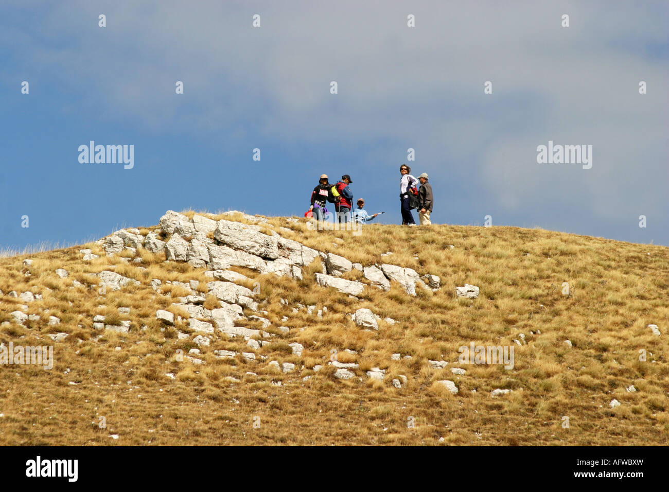 hikers enjoy Glorious colour at Sasso Tetto  mountain in the Sibillini National Park,Le Marche Italy Stock Photo