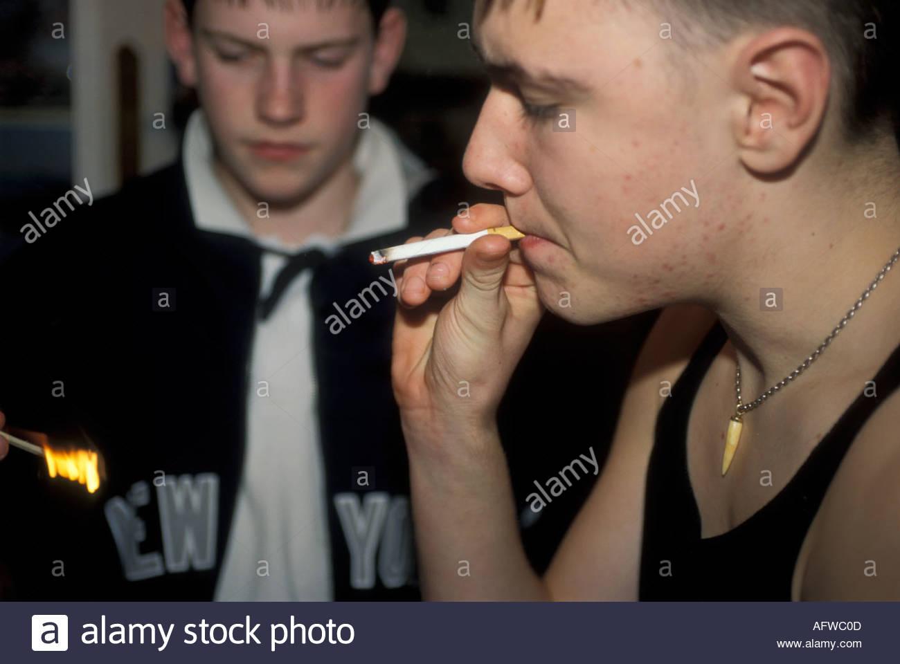 Teenage boys smoking in bedroom at home uk