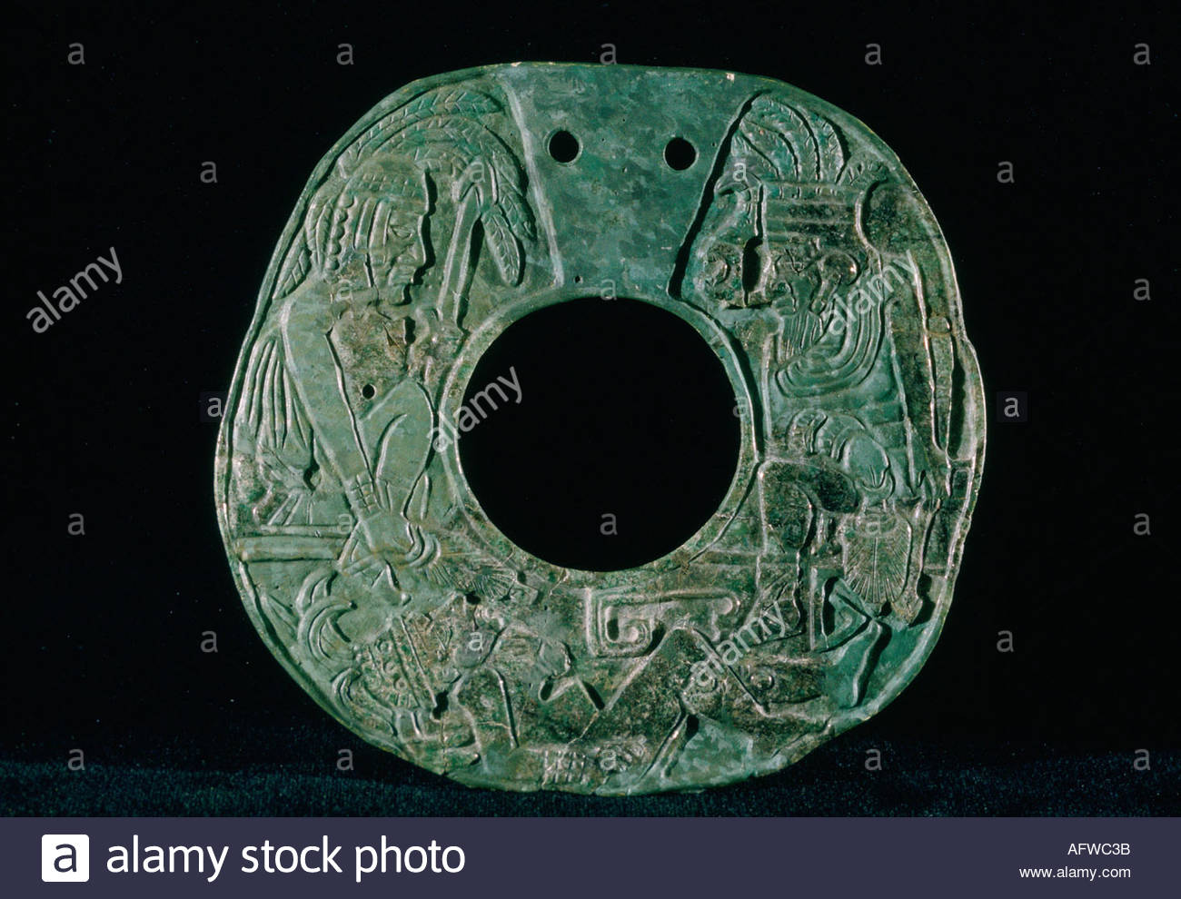 MEXICO Yucatan jade pectoral representing two warriors with spears and a prisoner Culture Maya Post classic - Stock Image