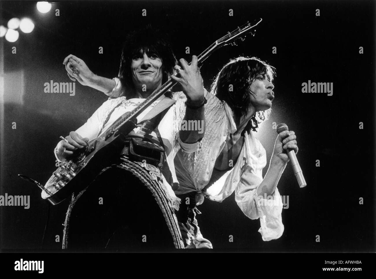 Mick Jagger, Ronnie Wood of The Rolling Stones London UK 1976.1970s UK Earls Court Concert HOMER SYKES - Stock Image