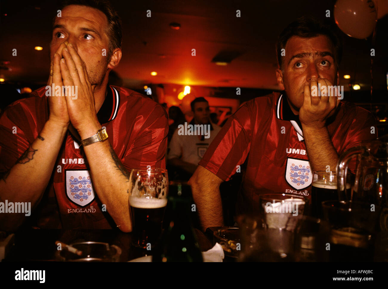 English football watching their favorite team on  multi screens television room in a Sports bar  London 1998 HOMER Stock Photo
