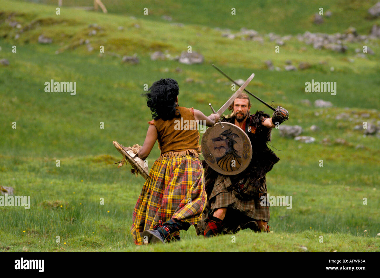 THE CLAN GROUP RE ENACTMENT OF ANCIENT SCOTTISH BATTLES  REENACTMENT BATTLE OF  CULLODEN HOMER SYKES - Stock Image