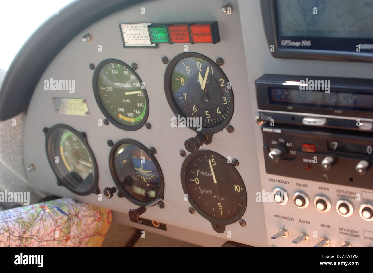 Airplane interior featuring Russian instruments and a European design just after takeoff. Climbing at 500 meters/min - Stock Image