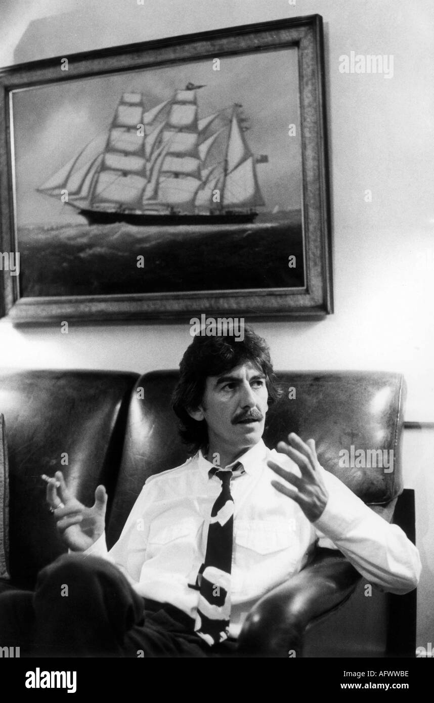 Portrait of George Harrison in his office London 1982 during an interview - Stock Image