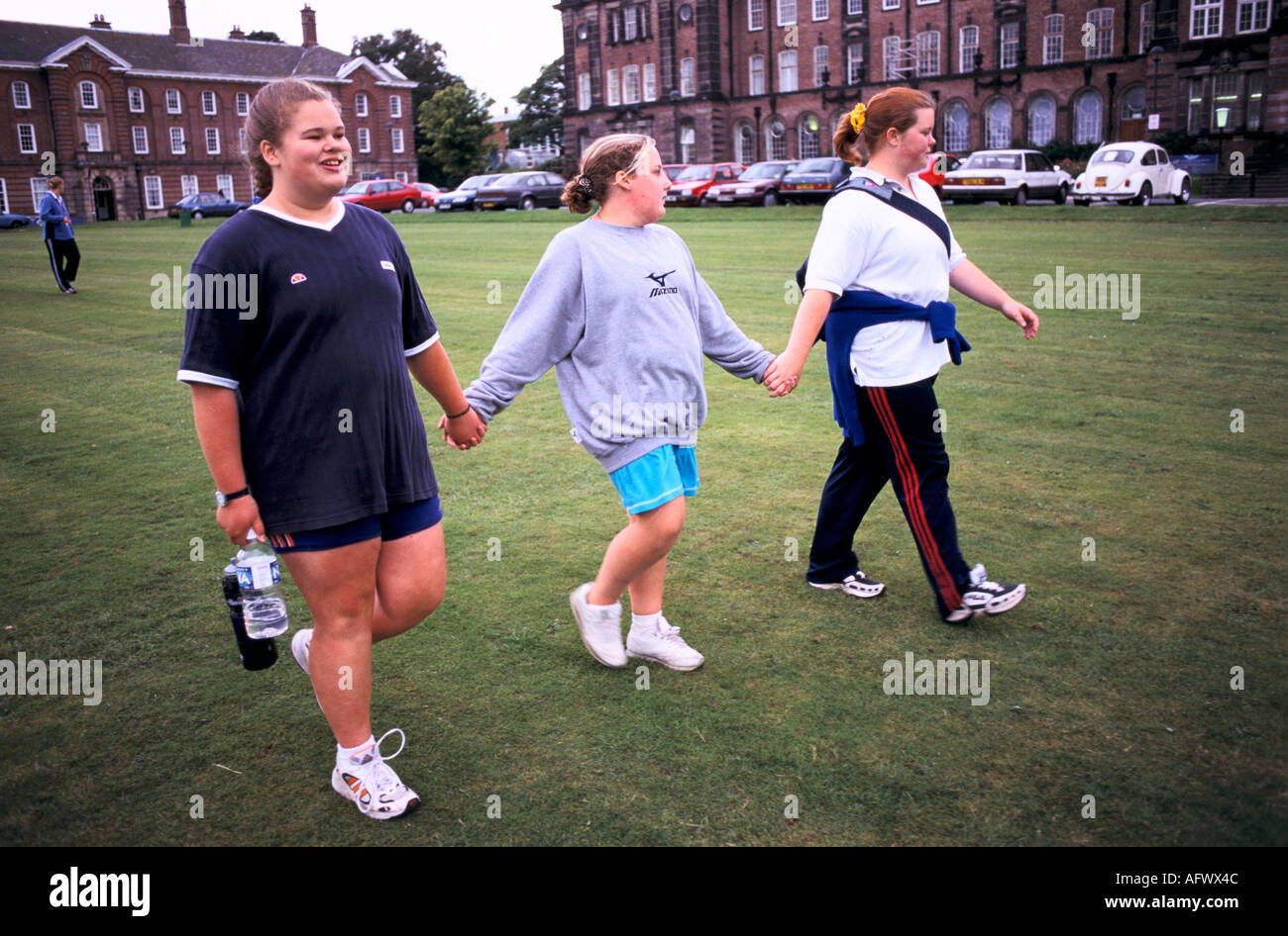 Overweight Unfit Obese Teen Girls Bonding Holding Hands After An Stock Photo Alamy