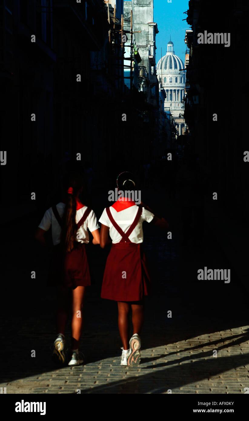 Cuba Havana Habana Vieja school children in uniform the Brasil or Teniente Rey street leading to the Capitolio - Stock Image