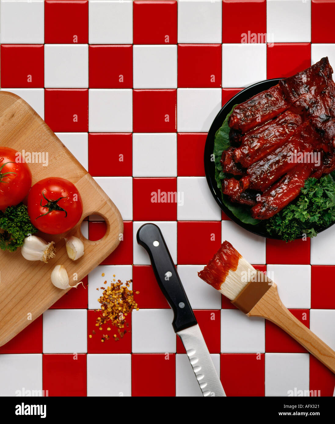 bbq barbecue ribs on red and white checker tile food Stock Photo