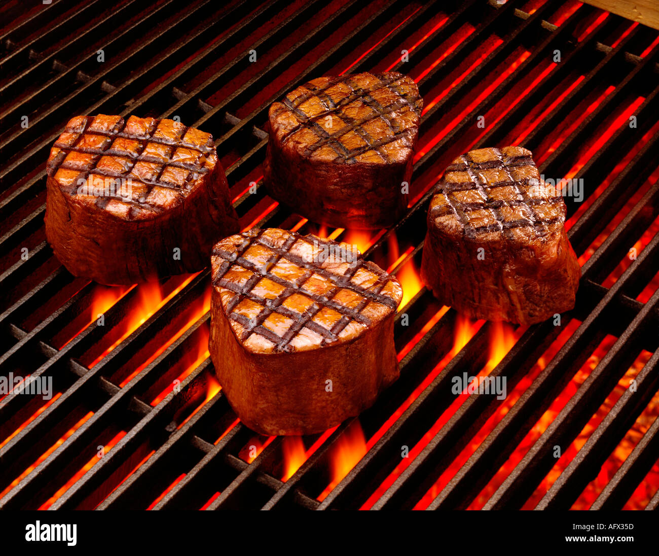 Steaks Cooking On Grill With Flames Filet Mignon Food Stock Photo