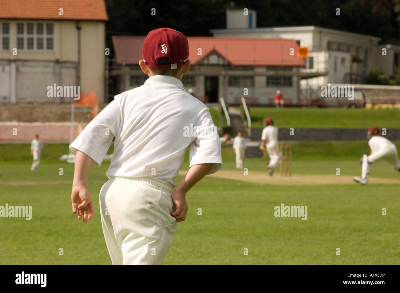 young boy fielding in Welsh Under 10's national school cricket competition Aberystwyth Summer 2007 UK GB Britain - Stock Image