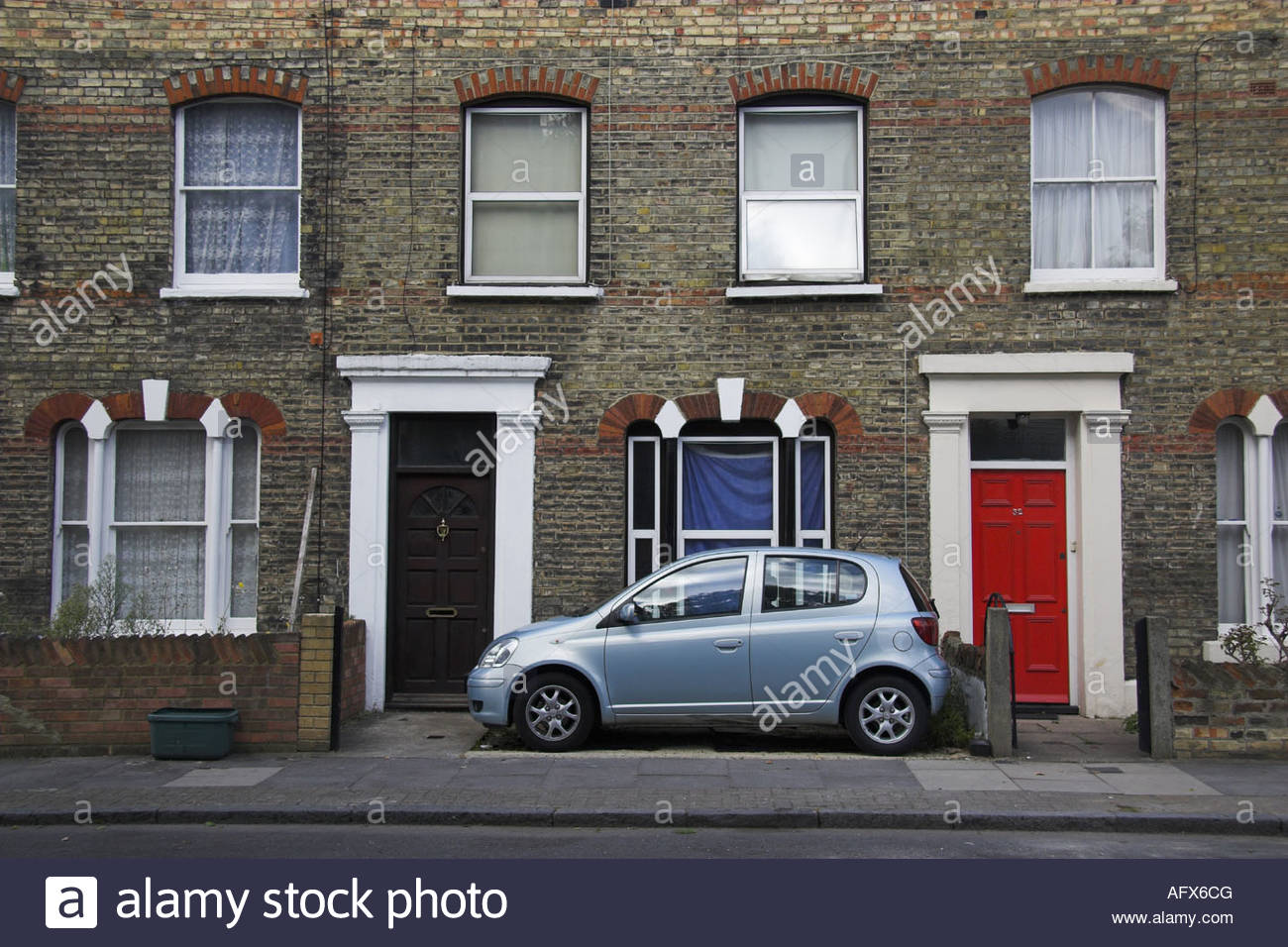 little car parked in a tiny front garden in Finsbury Park, London, UK. - Stock Image