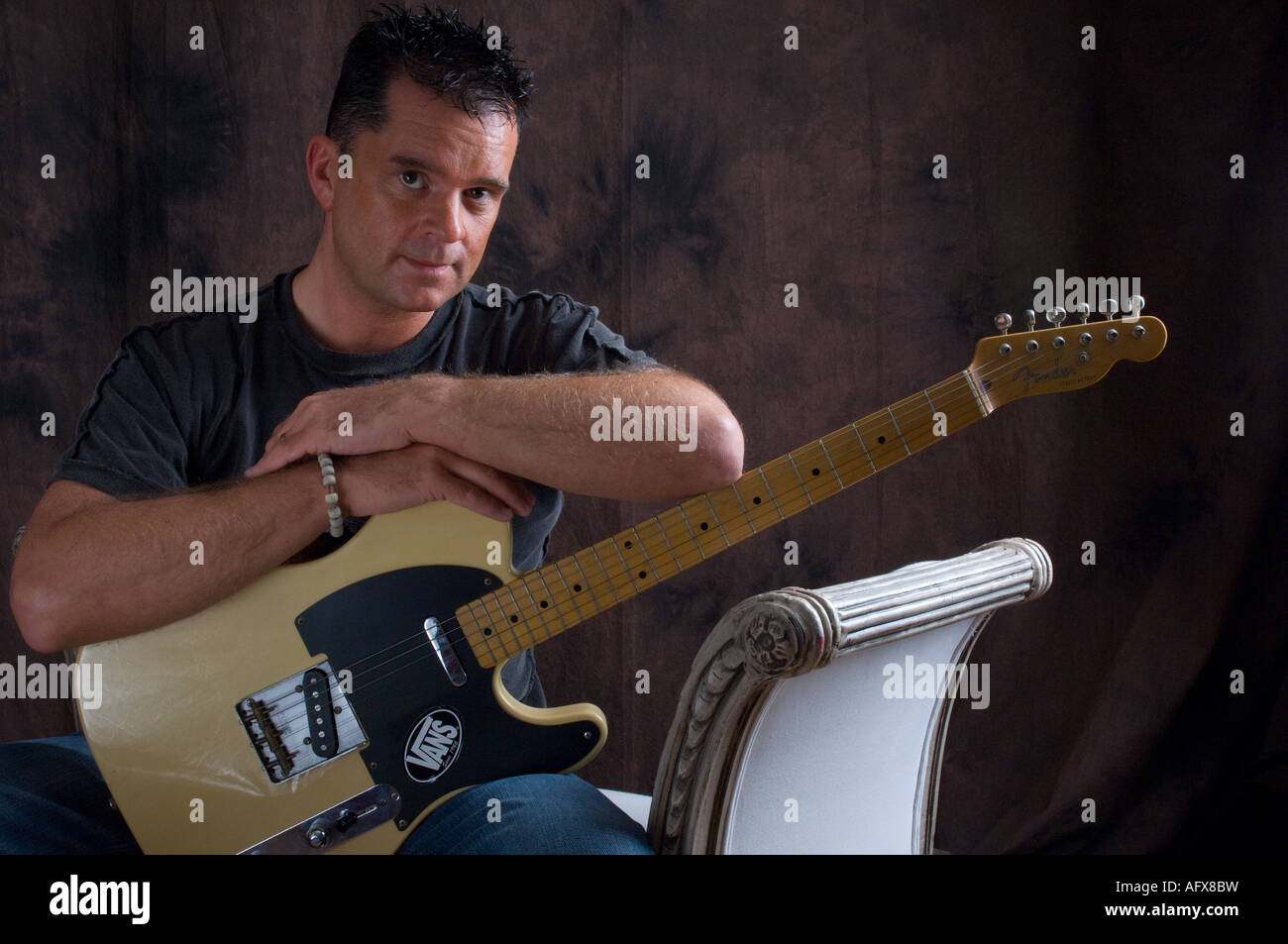 40 year old male musician holding iconic blonde fender telecaster ...