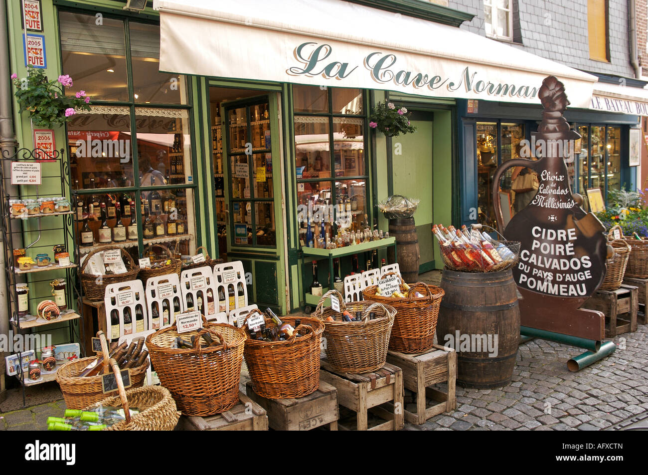 Local produce store selling drinks at Honfleur in Normandy France - Stock Image