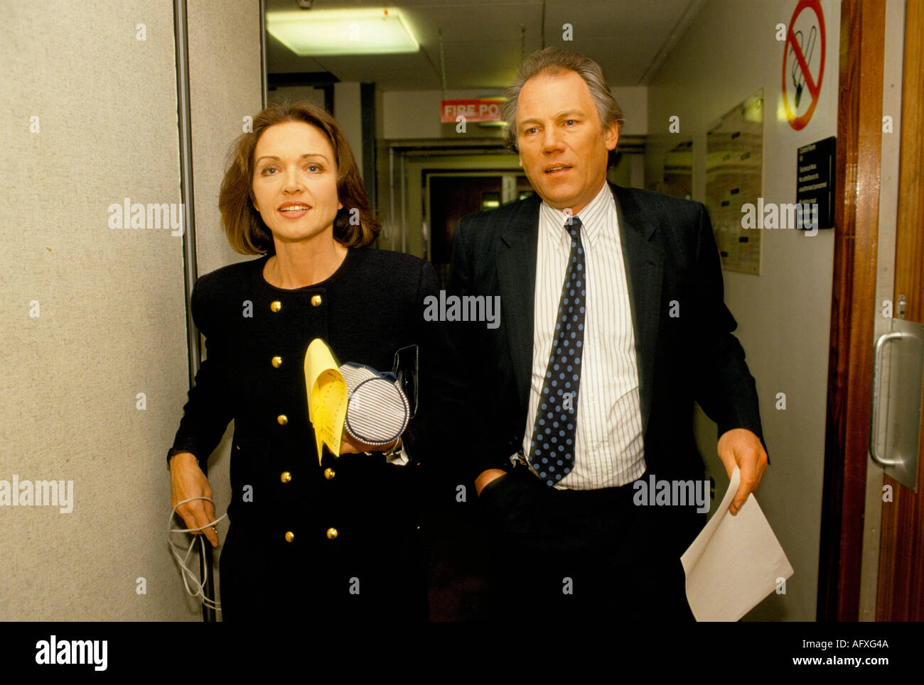 Colour portrait of Anna Ford and Peter Sissons British Television News presenters walk to the studio - Stock Image