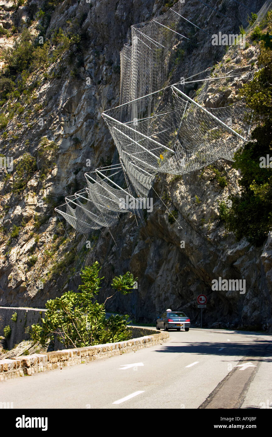 Wire netting used to stop rocks falling onto the road in the Alpes Maritimes, France - Stock Image