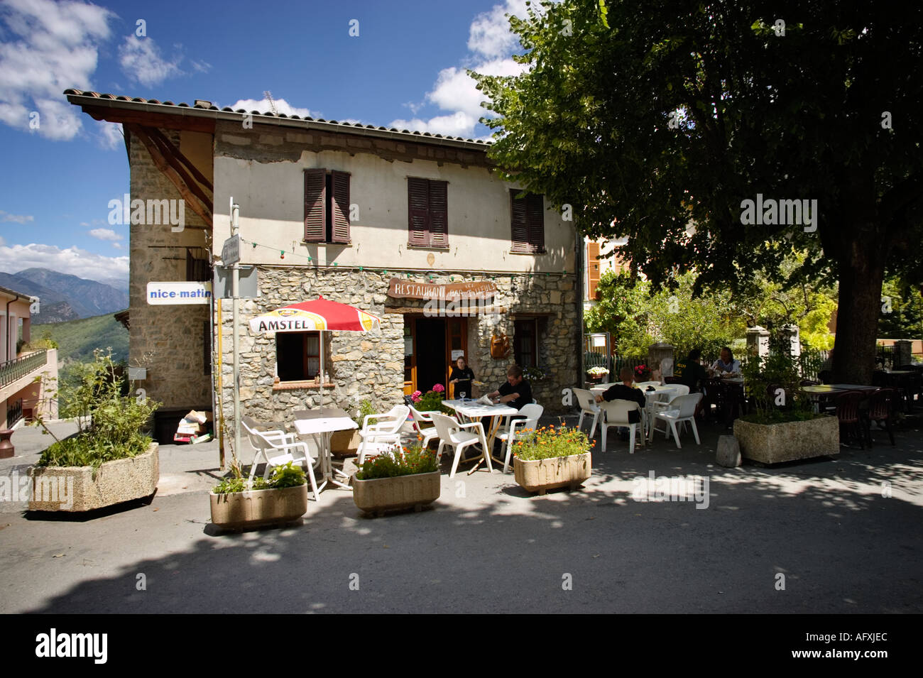 Restaurant cafe bar in the village square at Clans in the Alpes Maritimes, Provence, France - Stock Image