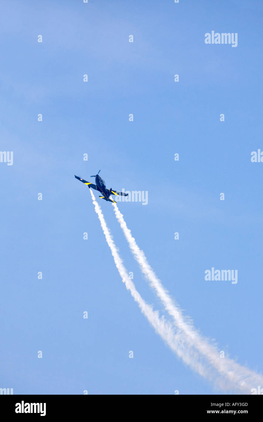 Pilatus PC-7 Turbotrainer Royal Netherlands Air Force flies in blue sky  at Fairford International Airshow - Stock Image