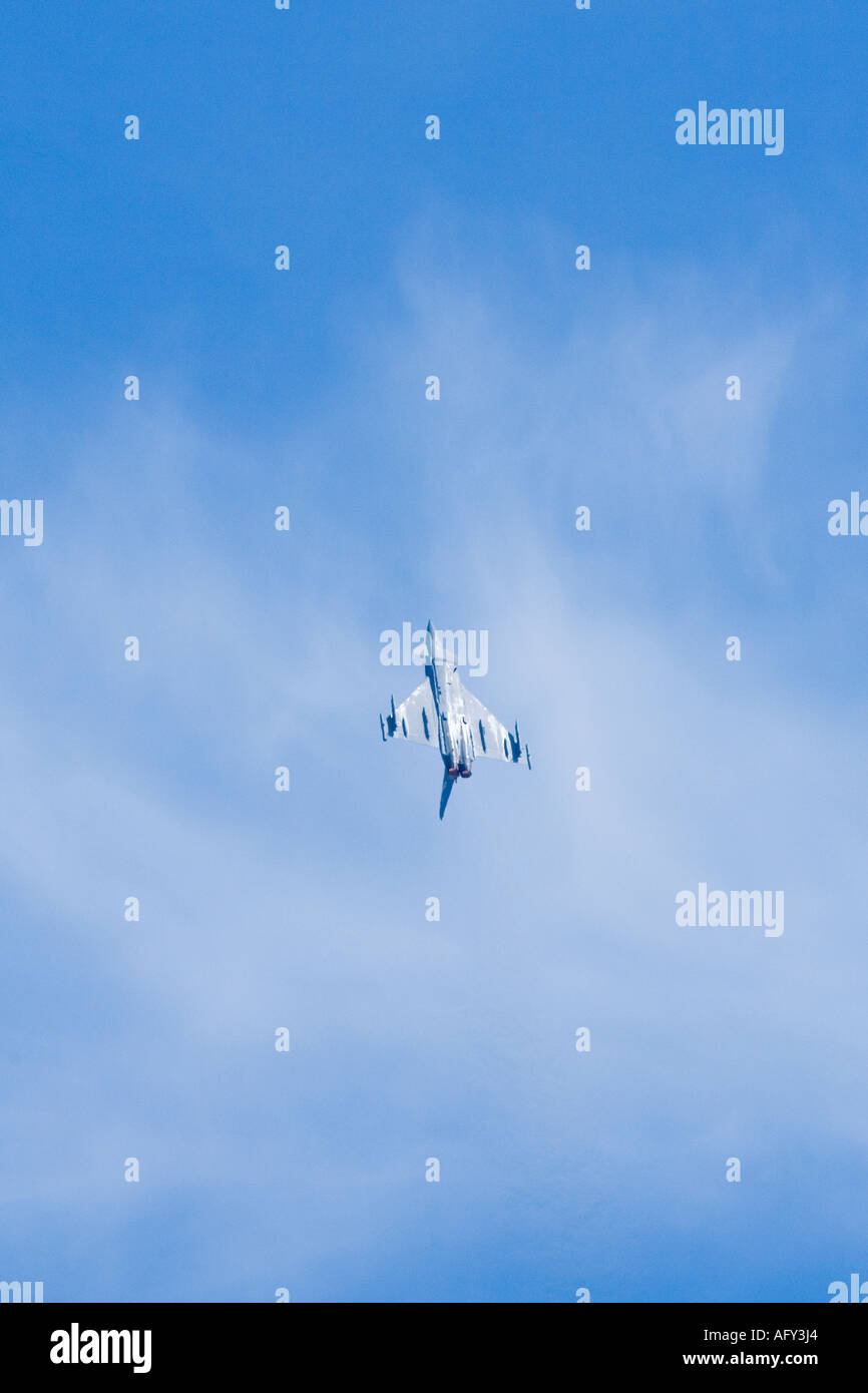 Eurofighter Typhoon F2 Royal Air Force flies upside down in steep climb in blue sky Fairford Stock Photo