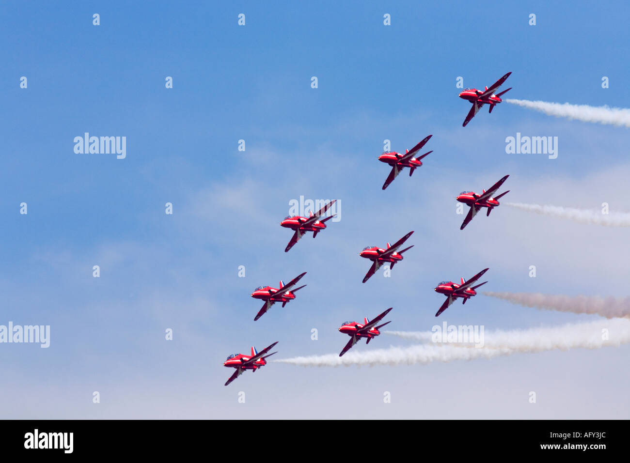 Red Arrows Royal Air Force RAF aerobatic display team in Hawk trainer aircraft at Fairford international air show 2006 display - Stock Image