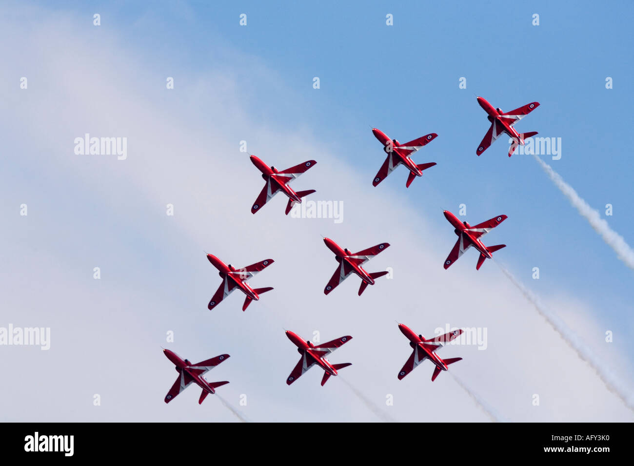 Red Arrows Royal Air Force RAF aerobatic display team in Hawk trainer aircraft at Fairford international air show display - Stock Image