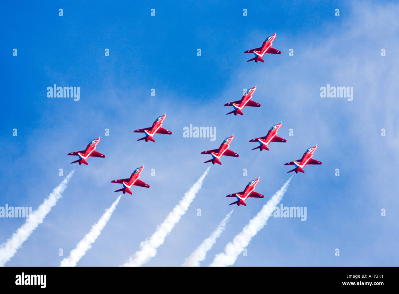 Red Arrows Royal Air Force RAF aerobatic display team in Hawk trainer aircraft at Fairford international air show Stock Photo
