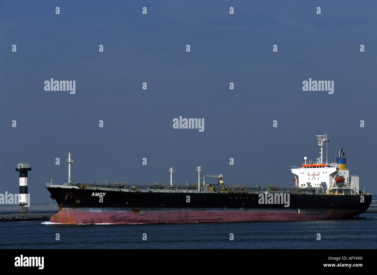 'Amoy' oil tanker leaving the port of Rotterdam, Holland. - Stock Image