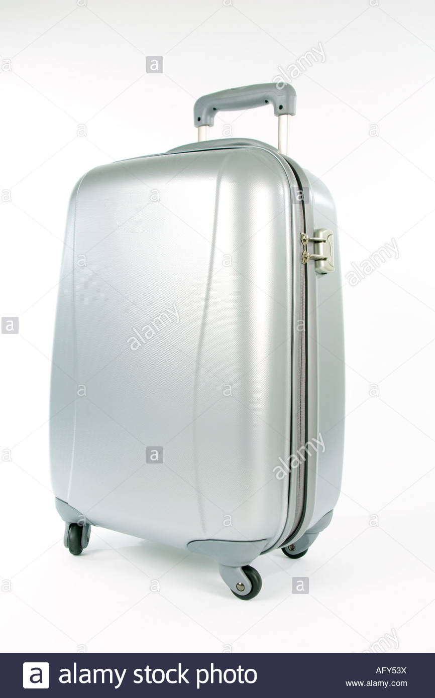 Silver hard suitcase with wheels and handle - Stock Image