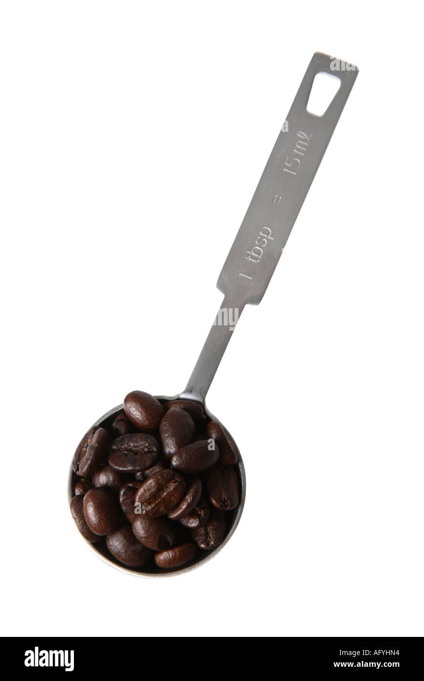 Measuring Spoon filled with Coffee Beans - Stock Image