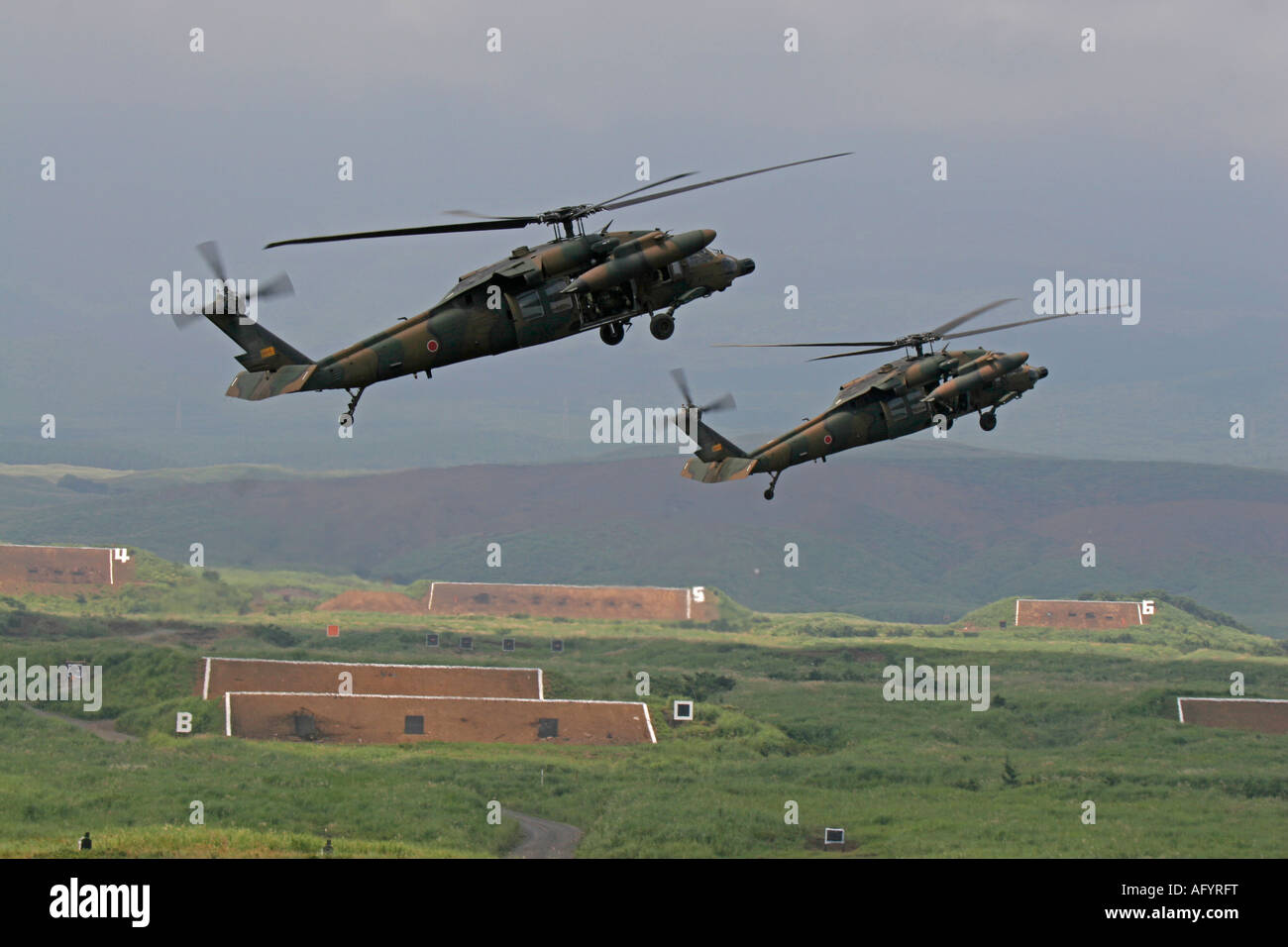 Formation flight of two SikorskyUH-60JA Black Hawk helicopters of Japan Ground Self Defence Force Stock Photo