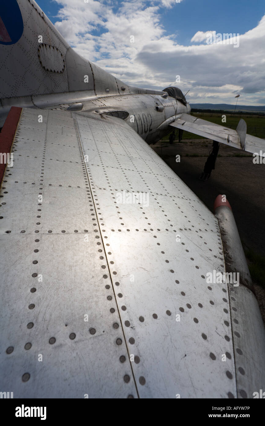 Exaggerated wide angle view of metal riveted tailplane of retired MiG-19 fighter aircraft Stock Photo