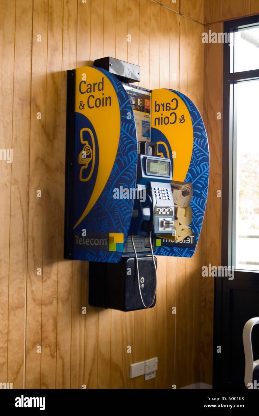 new zealand telephone kiosk hanging on wall - Stock Image