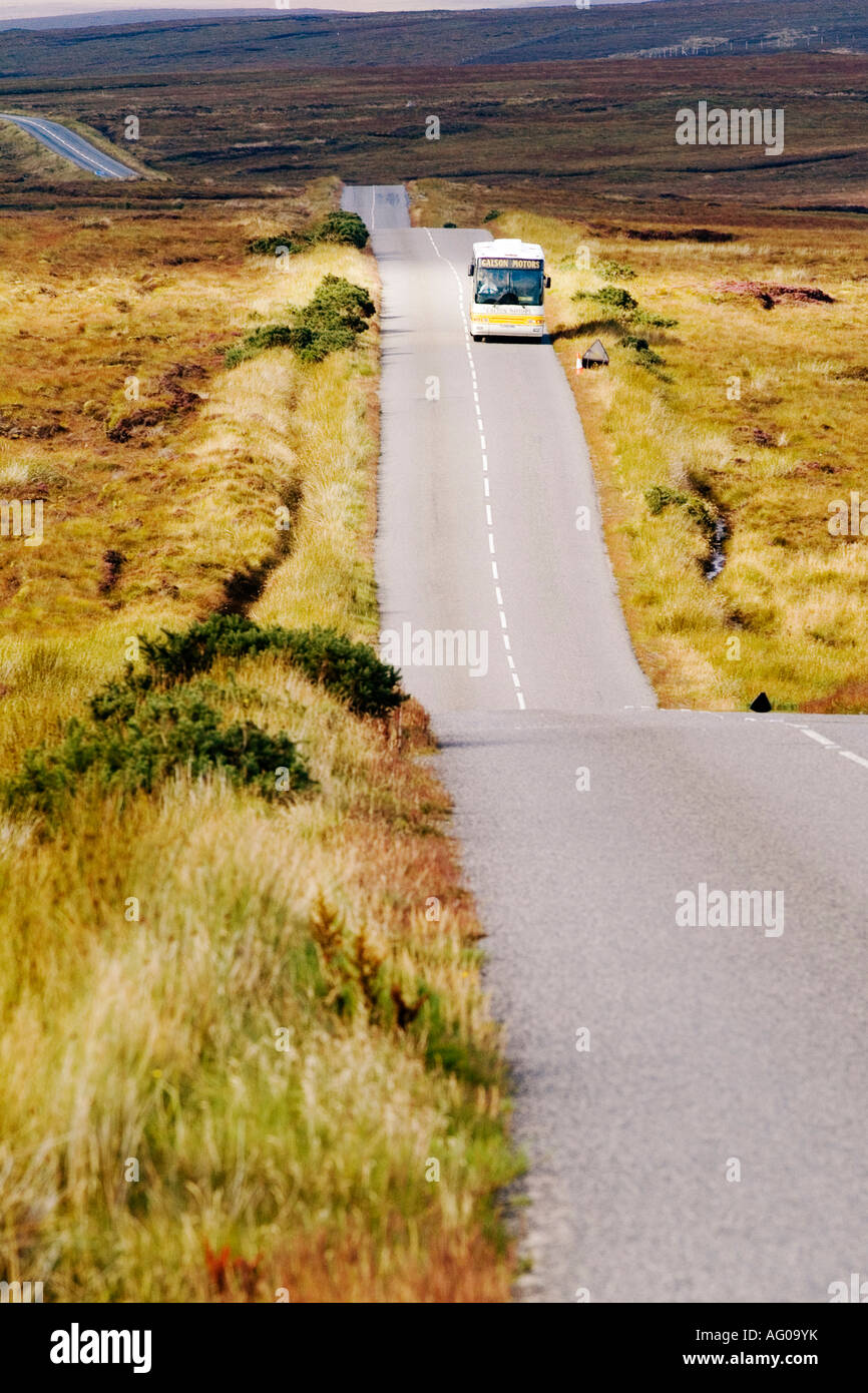 coach on empty country road - Stock Image