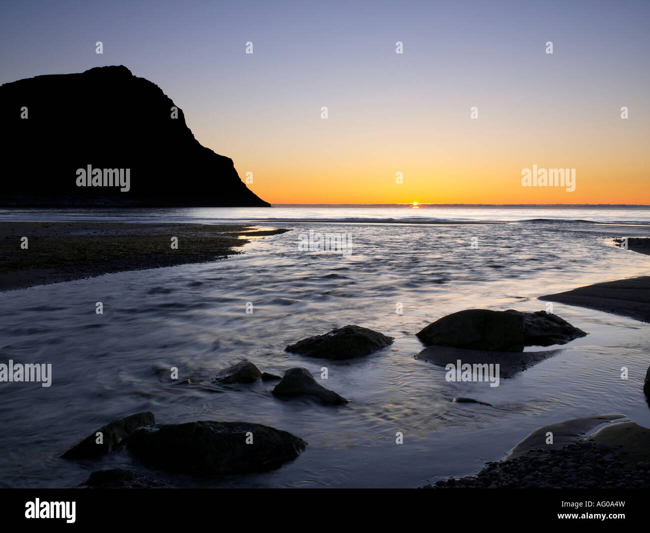 Midnight sun on black sand beach, Mt Ernir,  Bolungavik, West Fjords, Iceland - Stock Image