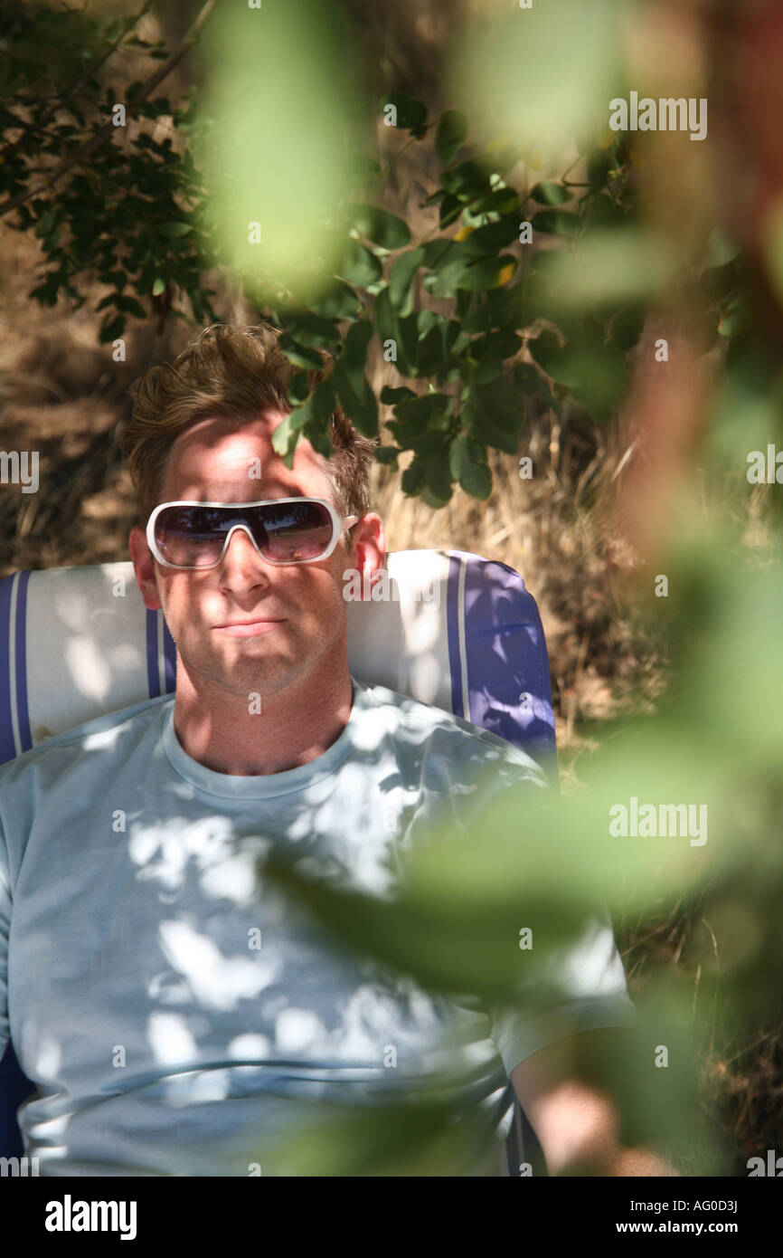 Portrait of a man relaxing. - Stock Image