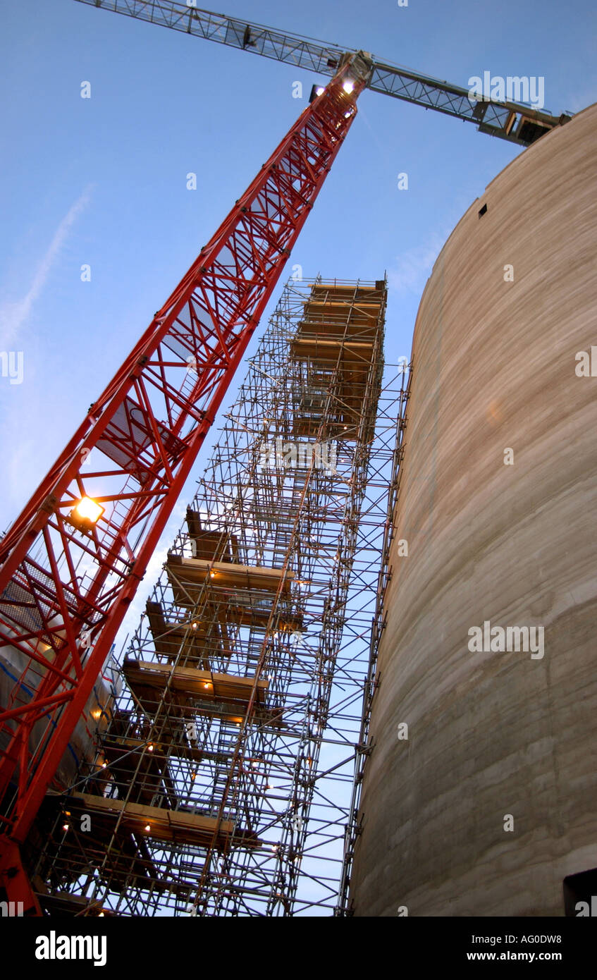 Dynamic shot looking up at a Red Crane and scaffold tower at Cottam Power Station, in Nottinghamshire UK - Stock Image