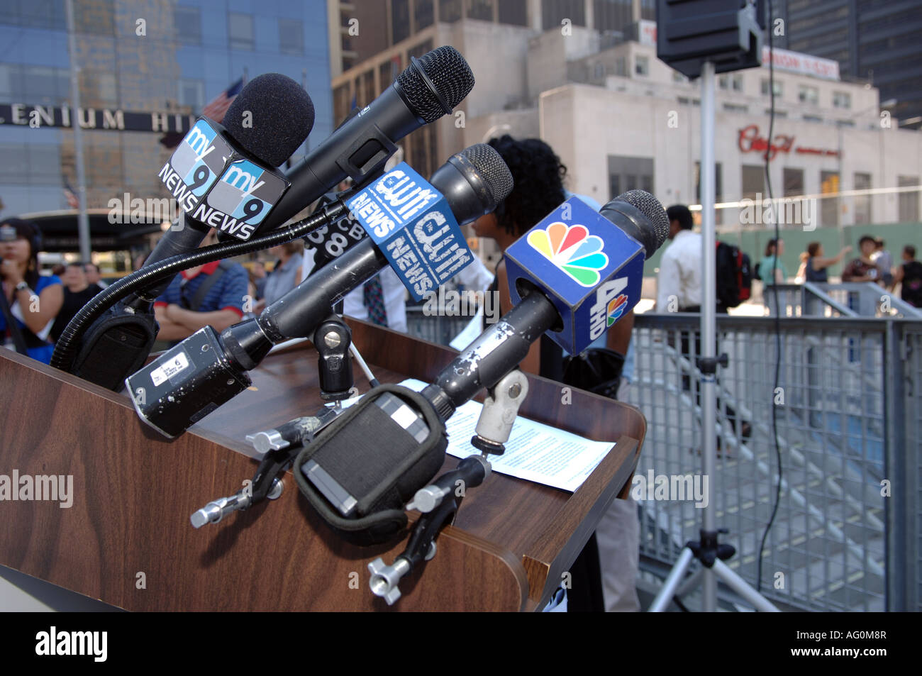 Collection of television station microphones on a podium - Stock Image