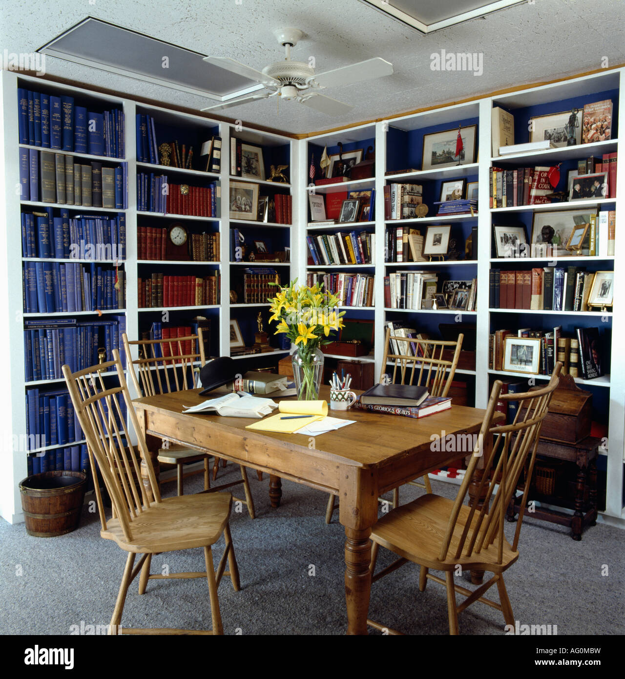 Antique pine table and chairs in eighties dining room study with walls of  bookshelves - Antique Pine Table And Chairs In Eighties Dining Room Study With