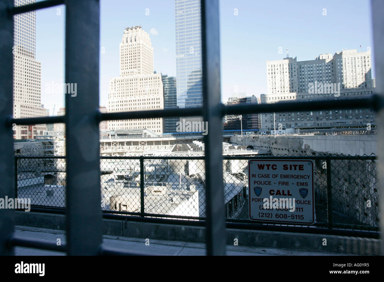 looking through the metal fence down onto the world trade center reconstruction site ground zero new york city new york USA - Stock Image