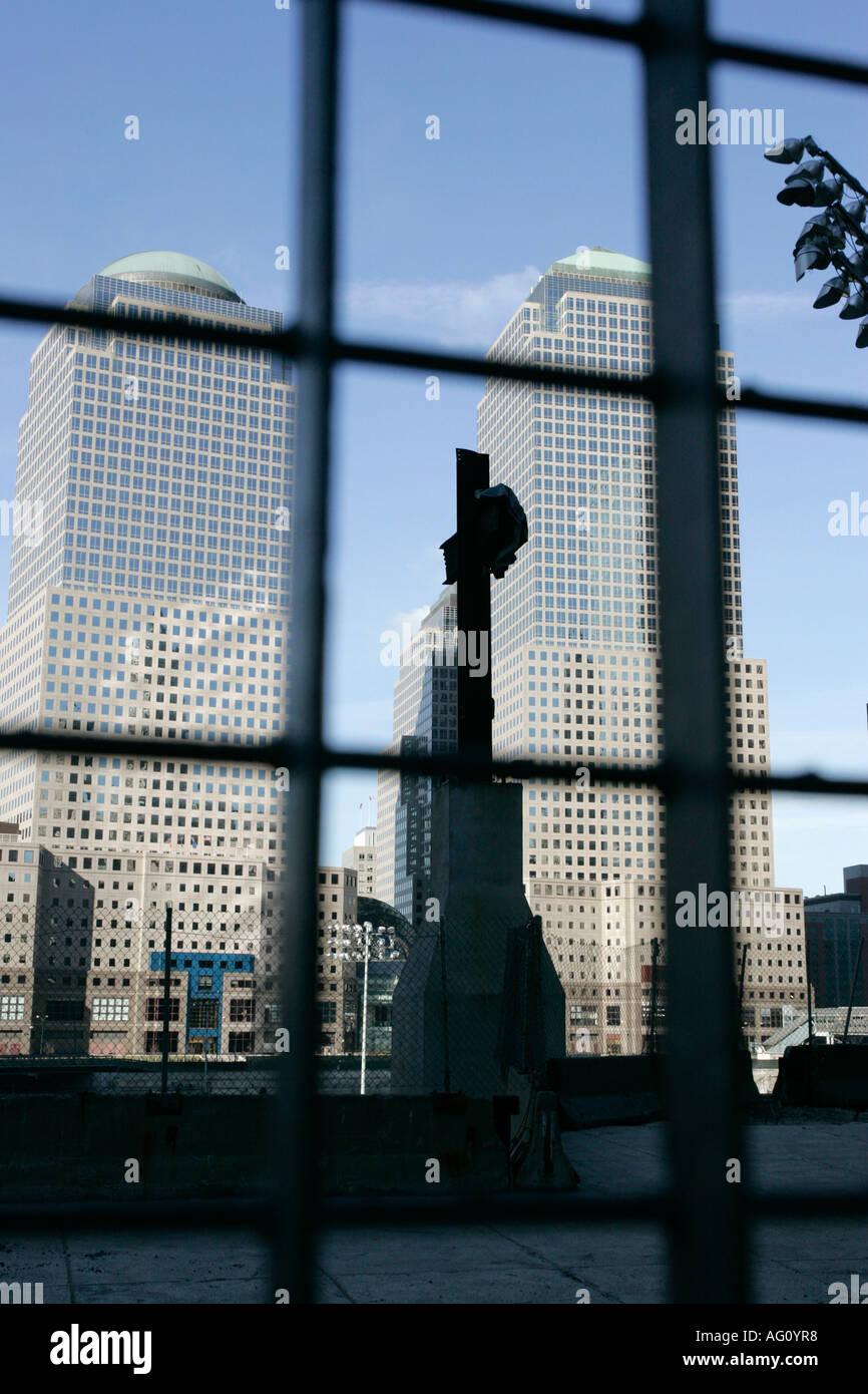 world trade center memorial cross with world financial centre buildings behind ground zero new york city new york USA - Stock Image