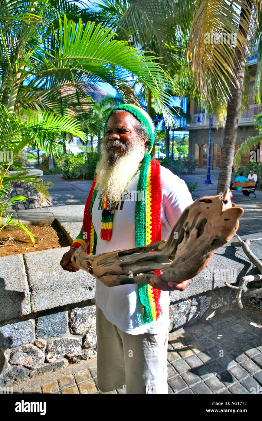 Local artist with one of his carvings - Caudan, Mauritius Stock Photo