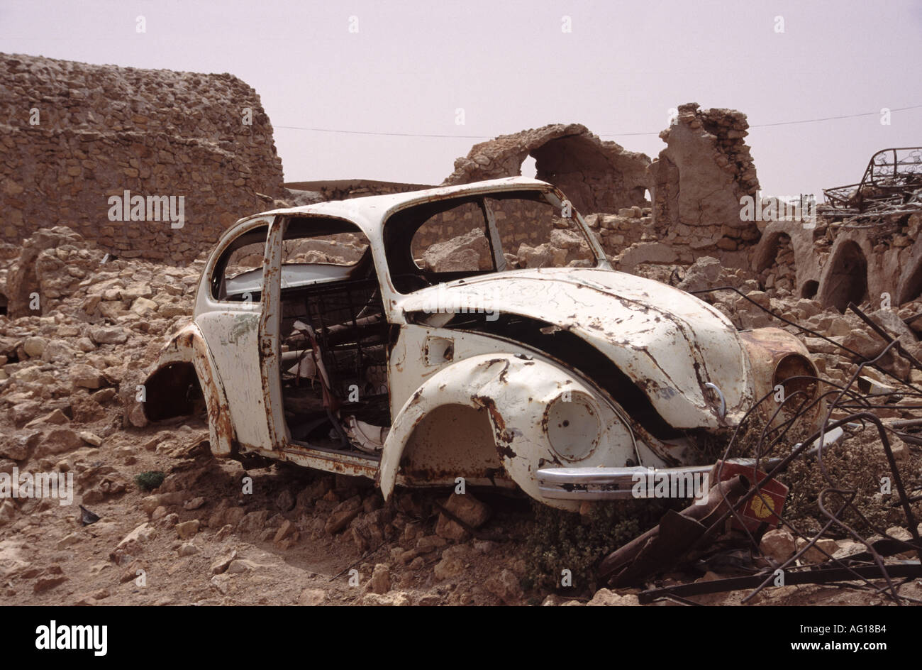 car wreck of an old vw beetle seen in Libya - Stock Image