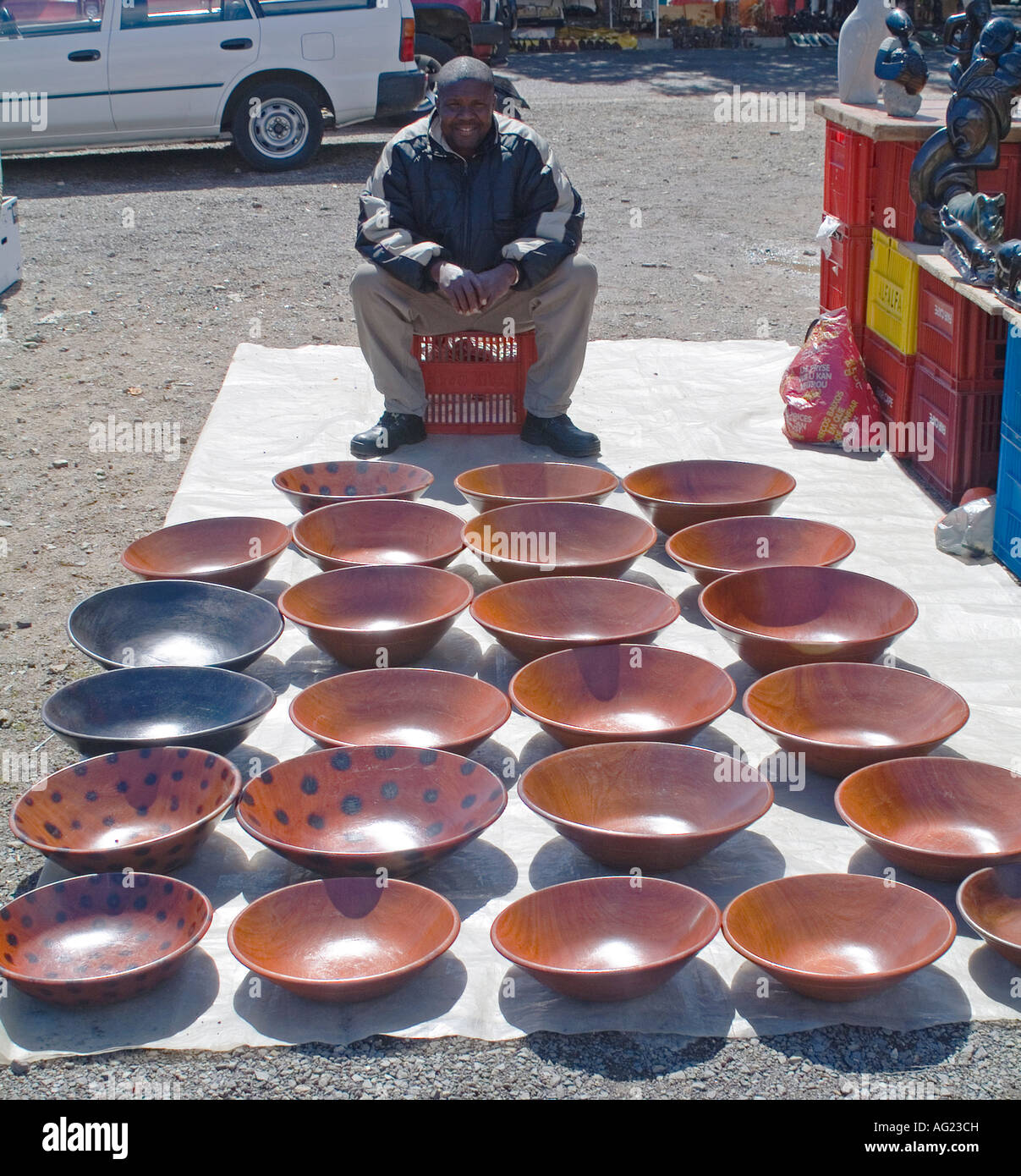 African Man Selling Hand Carved Wooden Bowls At A Flea Market In
