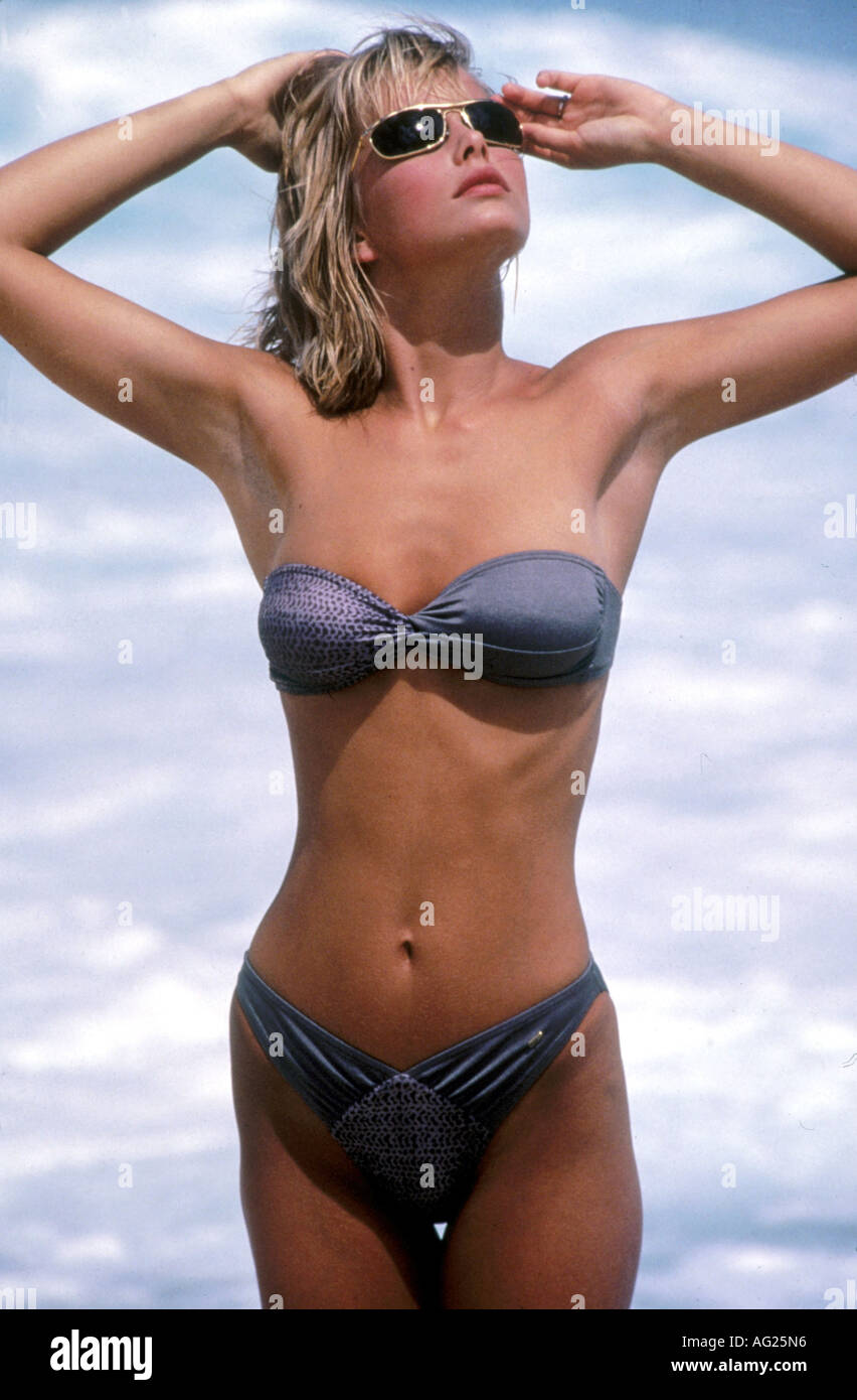 people, women, woman, half length, wearing bikini, circa 1991, 90s, 1990s, two piece, sunshades, sunglasses, top, bra, strapless - Stock Image